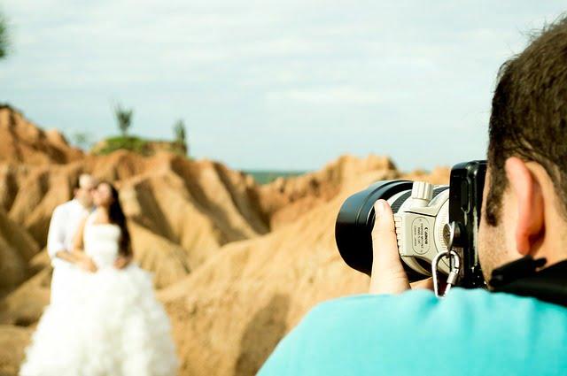 Photographer taking photo of wedding couple
