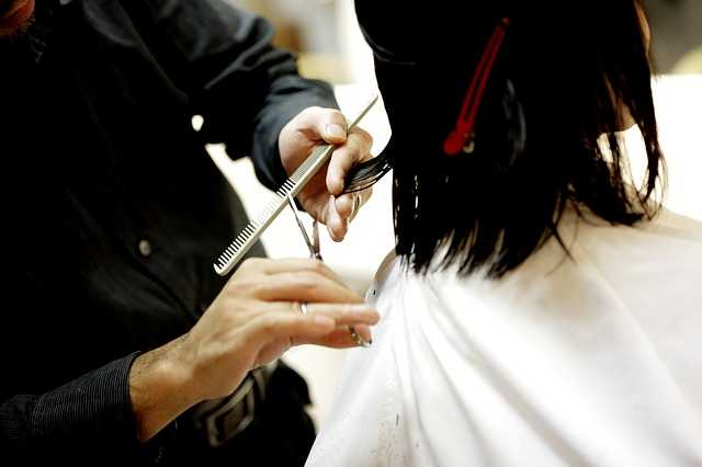 hair dresser cutting hair