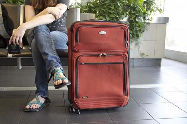 girl waiting on airport with luggage bags