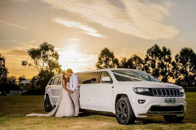 Wedding couple with white limo